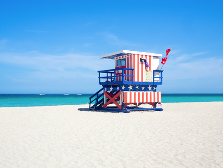 Famous lifesaver hut with the colors of the American flag at South Beach in Miami Фото со стока