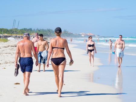 varadero: Tourists at the beautiful beach of Varadero in Cuba Stock Photo