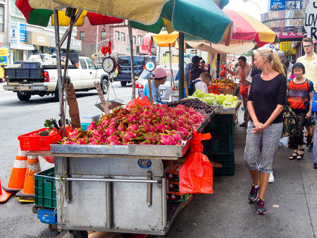 ny: Chinese immigrants selling exotic fruits at Chinatown in New York City