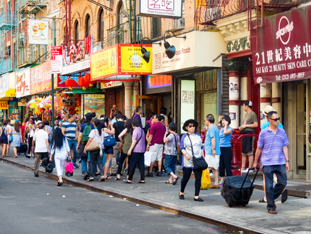 immigration: Tourists and chinese immigrants at Chinatown in New York City Editorial