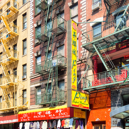 enclave: Colorful buildings with chinese signs at Chinatown in New York City