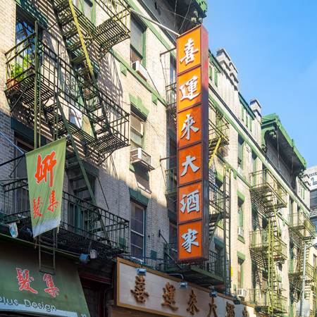 enclave: NEW YORK,USA - AUGUST 15,2015 : Colorful buildings with chinese signs at Chinatown in New York City Editorial