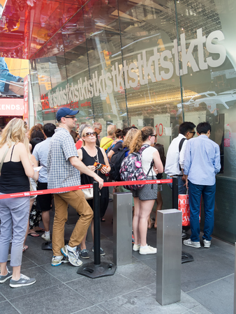 People at The TKTS booth on Times Square  buying tickets to Broadway shows in New York City