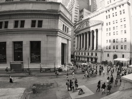 new york stock exchange: Tourists at the New York Stock Exchange on Wall Street in New York City