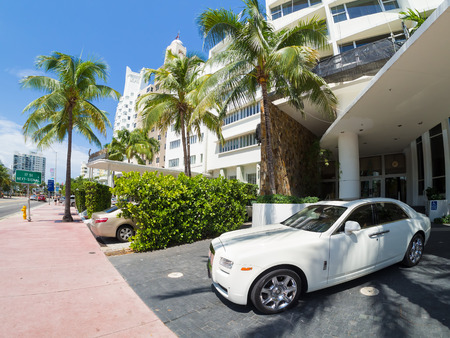Rolls Royce luxury car next to a famous hotel at Miami Beach Editorial