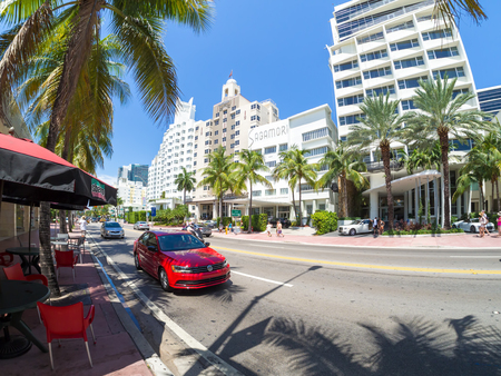 Street scene with famous hotels at Collins Avenue in Miami Beach Editorial