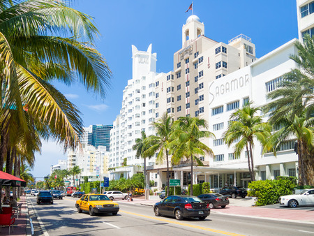 delano: Street scene with traffic and  famous hotels at Collins Avenue in Miami Beach