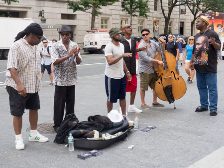 performers: Street performers singing and playing music at 5th Avenue in New York City