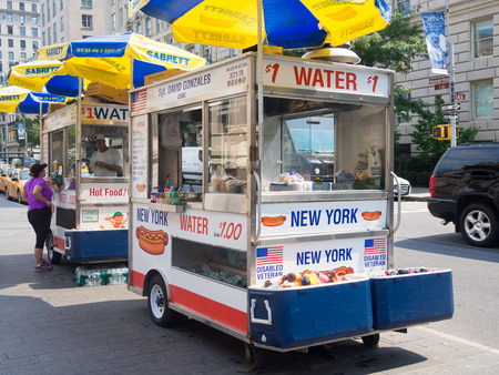 Fast food cart selling hot dogs and other snack in New York City