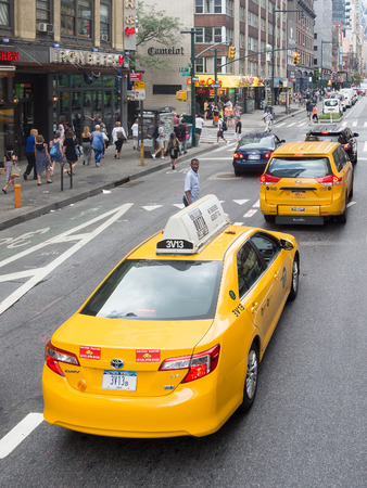 yellow cab: Street scene with people and yellow cab taxis in New York