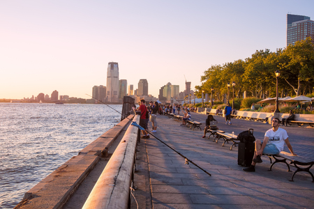 Battery Park in New York City at sunset Editorial
