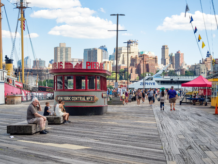 The South Street Seaport in downtown Manhattan with the Brooklyn skyline on the background