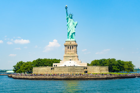 politics: The Statue of Liberty at Liberty Island in New York City on a beautiful summer day