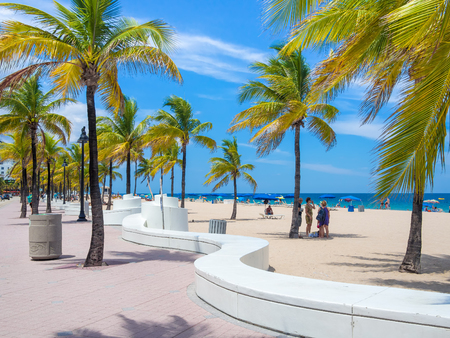 People enjoying the beach at Fort Lauderdale in Florida on a summer day
