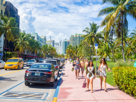 Street scene at Ocean Drive in Miami Beach on a beautiful summer day