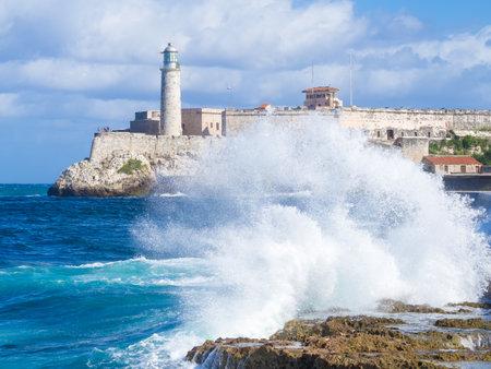 seawall: El Morro castle in Havana with sea waves crashing on the Malecon seawall Editorial