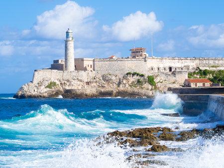 El Morro castle in Havana with sea waves crashing on the Malecon seawall Editorial