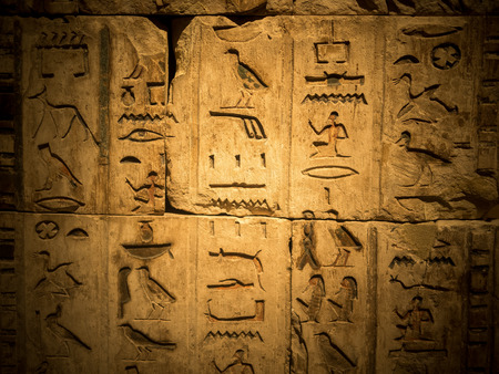 hieroglyph: Weathered ancient egyptian hieroglyph carved in stone Stock Photo