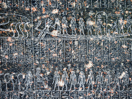 ancient egyptian civilization: Ancient egyptian hieroglyph depicting human figures carved in black granite stone