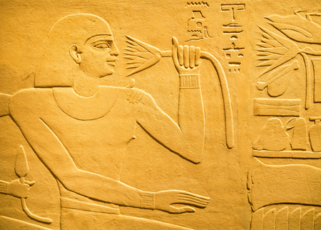 hieroglyph: Ancient egyptian hieroglyph carved in sandstone depicting a human figure