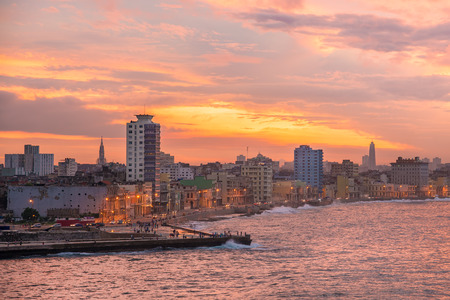 seaside: Sunset in Havana with a view of the seaside city skyline