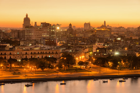 waterfront: Sunset in Old Havana with a view of  the bay and the Capitol building