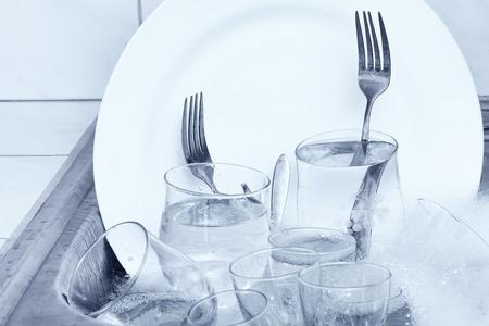 dishwashing: Dishwashing - Glassware,cutlery and dishes in the kitchen sink