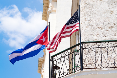 united states: Cuban and american flags together on a balcony in Old Havana Stock Photo