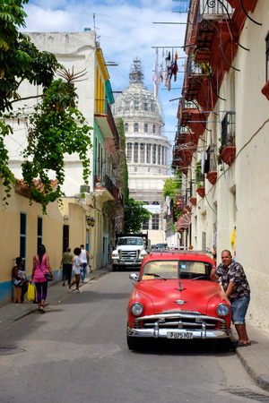 capitolio: Street scene in Old Havana with a vintage classic american car and the Capitol building Editorial