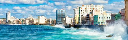 seawall: Panoramic view of the Havana skyline waves crashing into the Malecon seawall