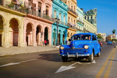 Street scene with old car and colorful buildings in Old Havana
