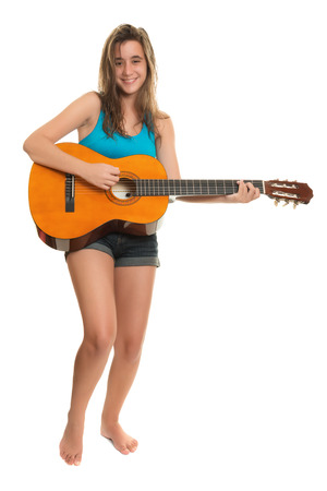 hispanic girl: Teenage girl playing an acoustic guitar - Isolated on a white background