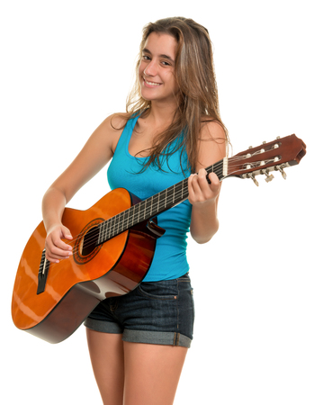 hispanic girl: Hispanic teenage girl playing an acoustic guitar - Isolated on a white background