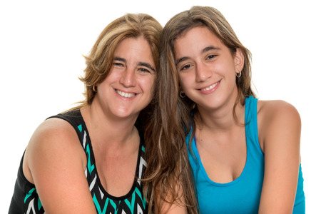 happy mom: Portrait of a happy mother and her teenage daughter - Isolated on white