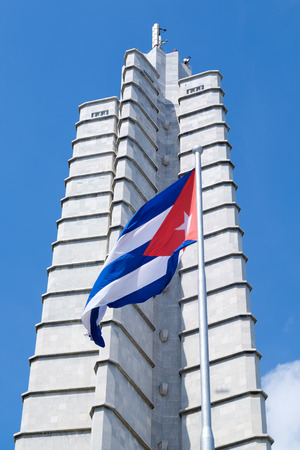 cuban: Monument and waving cuban flag at the Revolution Square in Havana Editorial