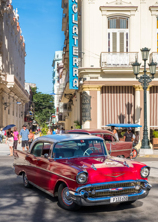 chevrolet: Classic red chevrolet in downtown Havana