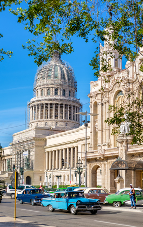 downtown capitol: Street scene with classic cars near the Capitol in downtown Havana Stock Photo