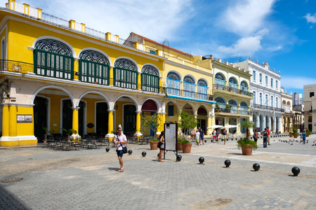 Tourists and locals at a colorful square on Old Havana
