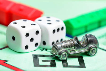 LONDON,UK - JULY 19,2016 : Monopoly game with the car token and dice Editorial