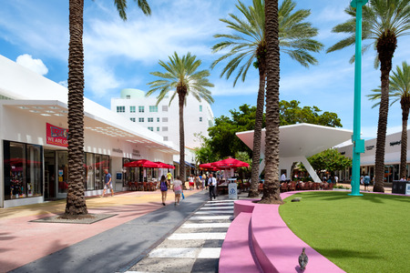 People, shops and restaurants at Lincoln Road, a famous tourist destination and shopping mall in Miami Beach