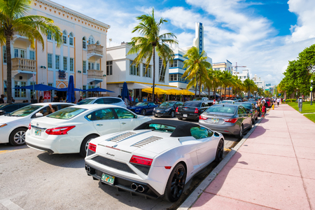 lamborghini: Tourists and luxury cars  at Ocean Drive, a popular tourist destination and home of several famous hotels, restaurants and discos in Miami Beach Editorial