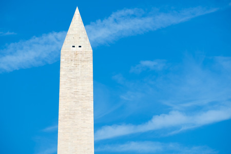 national monuments: The Washington Monument in Washington D.C. with a blue sky background Stock Photo