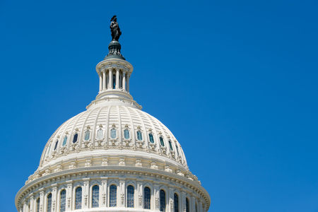 us capitol: The dome of the US Capitol at Washington D.C. on a blue sky background