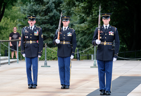 tomb unknown soldier: Changing of the guard at the Tomb of the Unknown Soldier at Arlington National Cemetery Editorial