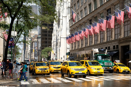 Yellow cabs next to Saint Patricks Cathedral and Saks Fifth Avenue in New York City Editorial