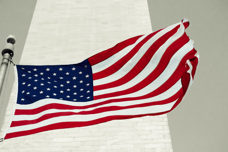 federal: American flag waving in front of the Washingtom Monument in Washington D.C. Stock Photo