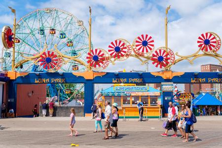 Ferris wheel and carrousel at the Luna Park amusement park at Coney Island