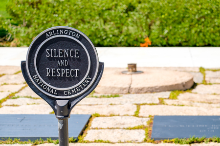 Sign demanding respect next to the Eternal Flame at the Arlington National Cemetery in Virginia, United States