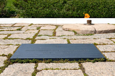 military cemetery: The Eternal Flame and the President John F. Kennedy tombstone at Arlington National Cemetery near Washington D.C.