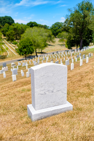 Tombstones on a grassy hill at Arlington National Cemetery near Washington D.C. Stock Photo